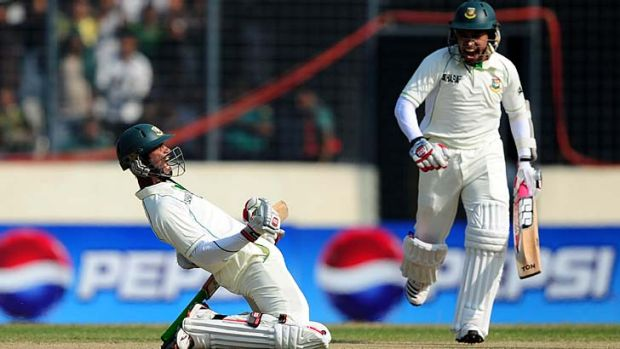 Naeem Islam (left) celebrates after reaching his maiden Test century as teammate Mushfiqur Rahim looks on.