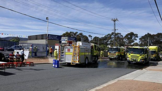 ACT Fire Brigade members at the scene of a fire at Brookes Street in Mitchell.