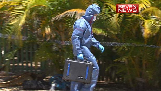 A forensics officer at the victim's Macleay Island home.