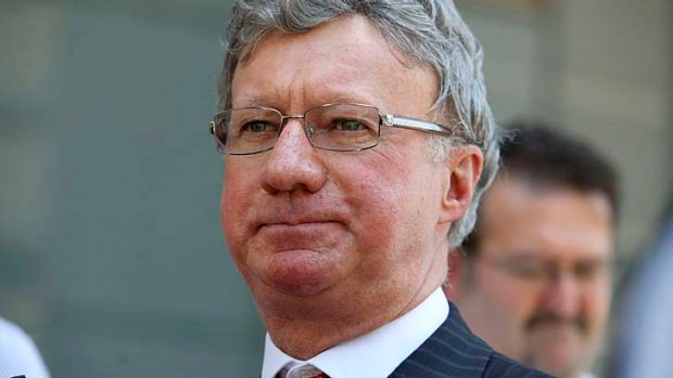 Chief Justice Paul de Jersey speaks to the media after police investigate a bomb threat at the Brisbane Supreme and ...