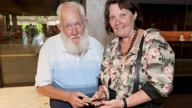 Former child migrant Michael Snell shows his diary to Margy Burn, Assistant Director-General, National Library of ...
