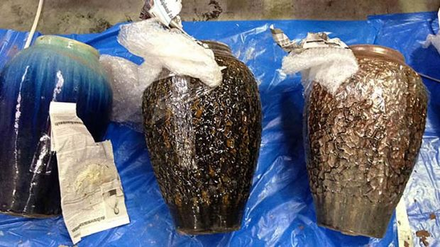 Packages of illegal drugs  concealed in terracotta pots that were found with a badly decomposed body on a yacht that  ...
