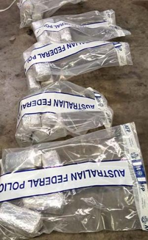 Packages of illegal drugs  that were found with a badly decomposed body on a yacht that  washed up on a Tongan atoll.