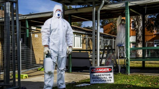 Jamie Carpenter (front), and Garry Harriden, removing asbestos from a local site in May this year.