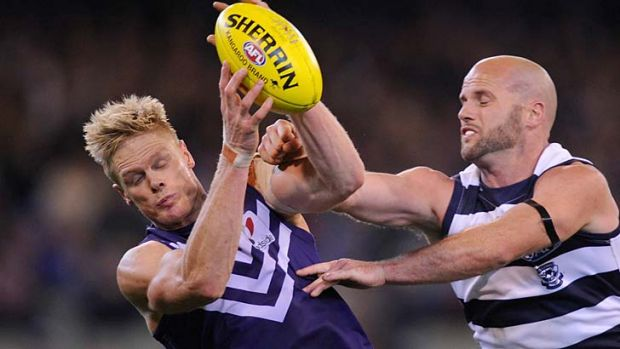 Fremantle's Adam McPhee outmarks Geelong's Paul Chapman during the Dockers' stunning upset of the Cats at the MCG in ...