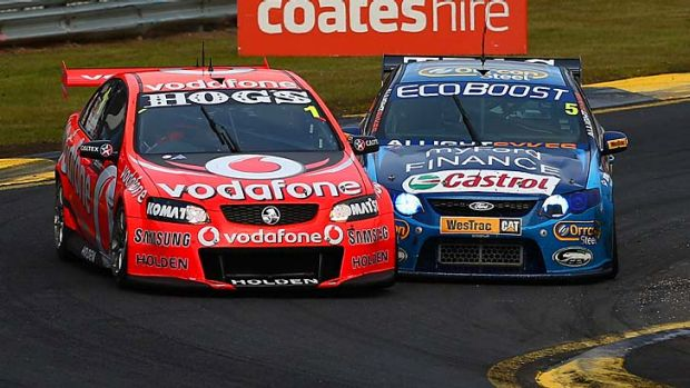 Mark Winterbottom (Ford) does battle with Jamie Whincup (Holden) in the Sandown 500 but Whincup only has to start at ...