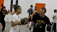 Morning sparring sessions between Redfern police and local youth at the National Centre for Indigenous Excellence in ...