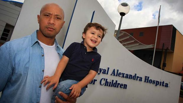 Nightmare ... Frank Puletua with his son Noah outside The Children's Hospital at Westmead.