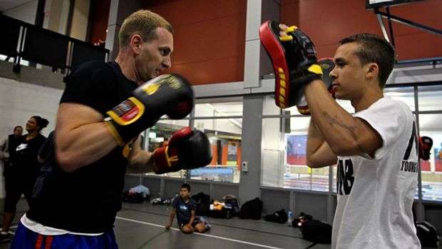 Making a fist of it ... Senior Constable Darryl Hawker and Kyle White don the gloves at the National Centre of ...