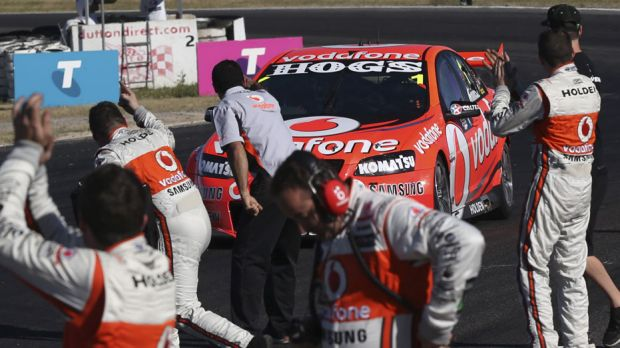 Over the line … Jamie Whincup shares victory with his crew at Winton on Saturday.