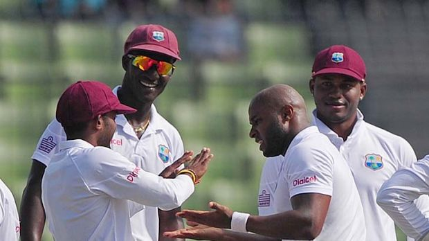 Tino Best (right) celebrates with teammates Sunil Narine, Darren Sammy and Marlon Samuels after he dismissed Bangladesh ...