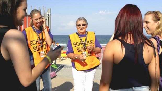 Volunteers Christine Harding, left, and Jeannie Ward, with some schoolies.