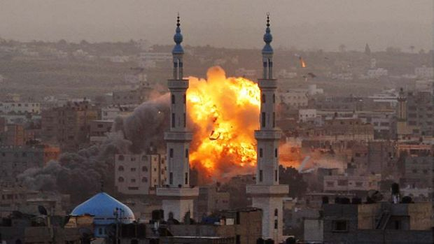 Inferno ... Gaza City in flames after Israeli air strikes.