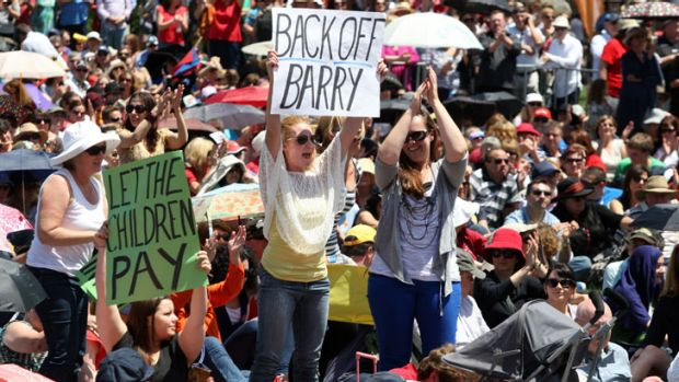 Fired up ... protesters in Darling Harbour. The Education Minister, Adrian Piccoli, said the savings would not affect ...