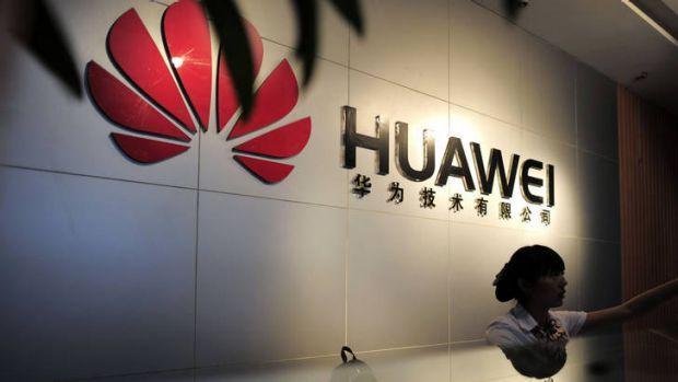 A receptionist sits behind the counter at the Huawei office in Wuhan, central China's Hubei province.
