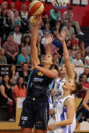 Canberra Capitals forward Brigitte Ardossi tries to make a basket.