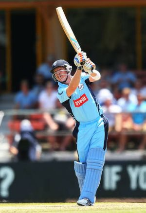 NSW batsman Brad Haddin hits one over the infield during Sunday's Ryobi Cup clash with Victoria.