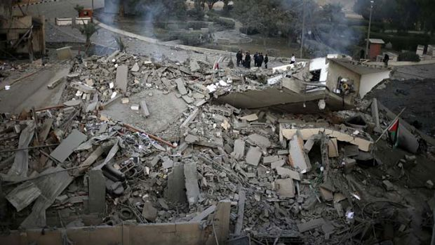 Targetted attack ... Palestinians inspect the destroyed office building of Gaza's Prime Minister, Ismail Haniyeh.