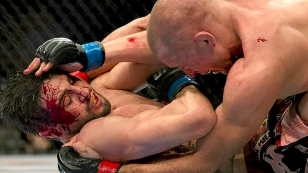 Carlos Condit, bottom, battles with Georges St-Pierre during their UFC welterweight title fight in Montreal.