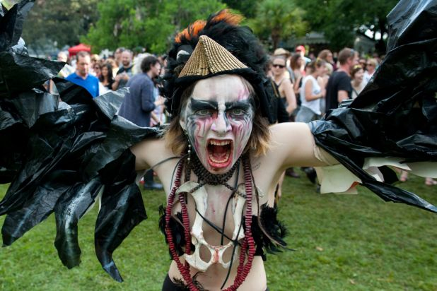 Performers dance past crowds at the 2012 Harvest Festival held at the city Botanic Gardens in Brisbane.