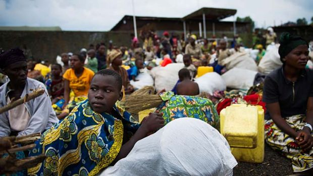 Under threat ... internally displaced Congolese sit inside a United Nations base outside Goma, seeking shelter after ...