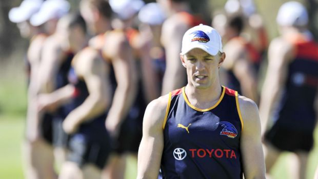 A standout: Crows star Nathan van Berlo hits the training track in Adelaide on Monday.