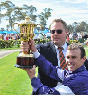 Owner Nick Williams and jockey Steven King with trophy after Tanby won the Bendigo Cup last year.