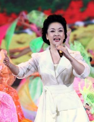 Dazzling singer ... Peng Liyuan during a grand celebration for National Day in Beijing.