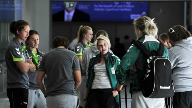 Canberra United players wait in departures at Canberra airport before heading to Japan.