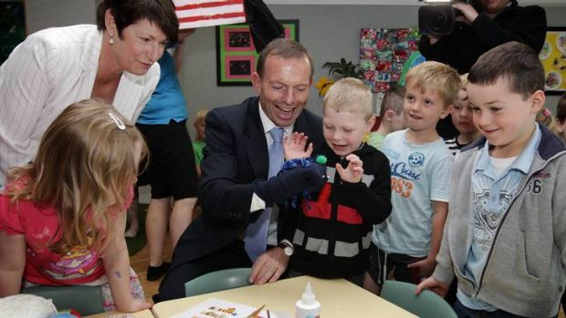 Opposition Leader Tony Abbott meets with children during his visit to the Majura Park Childcare centre together with his ...