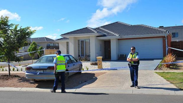 Police watch over the crime scene in Point Cook.