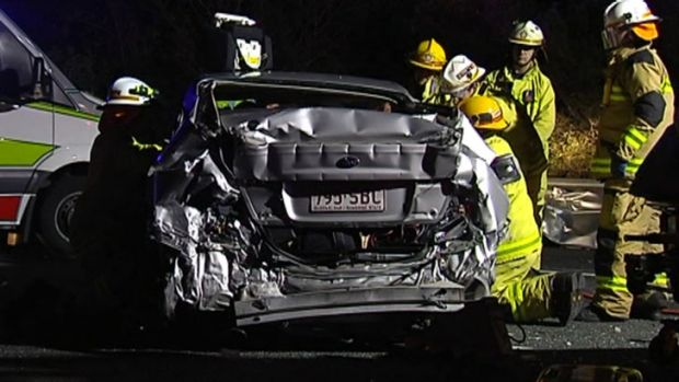 A man and woman escaped serious injury after after their car flipped and landed on its roof. Photo: Seven News.