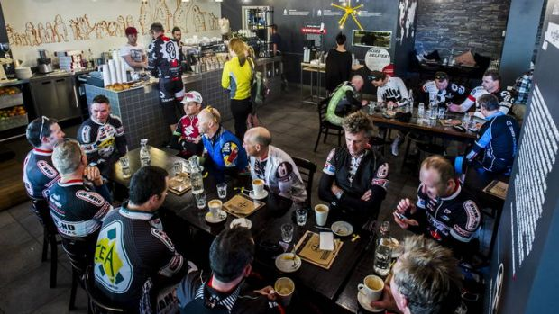 Cyclists drink morning coffees at Two Before Ten in the city.