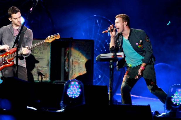 Chris Martin and Guy Berryman on bass guitar.