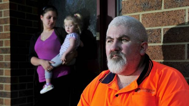 Michael Richer sits outside his house in Latham with his daughter Kylie Richer and granddaughter Sarah Watson after he ...