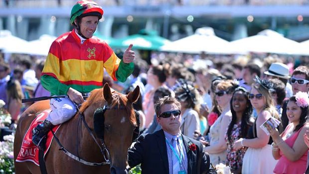 Happy days: Damien Oliver, pictured on Happy Trails after winning the Emirates Stakes, has been banned for 10 months.