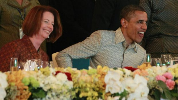 Relaxed in Phnom Penh: Prime Minister Julia Gillard with President Barack Obama at the East Asian Summit dinner.
