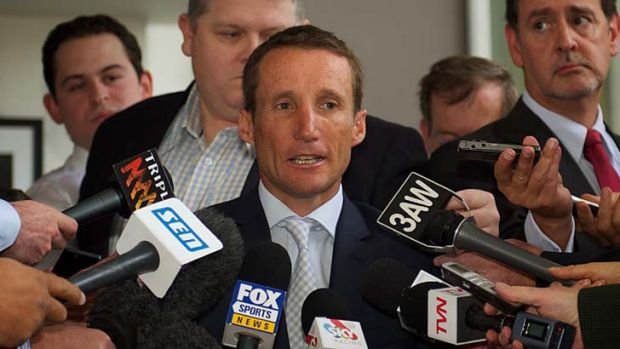 Upset … Damien Oliver addresses the media.