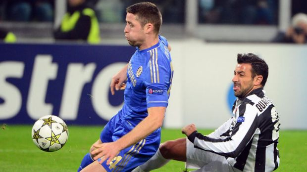 Juventus forward Fabio Quagliarella fights for the ball with Chelsea defender Gary Cahill.
