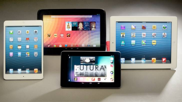 The white-framed iPad mini (left) and standard iPad (far right), with the Samsung Nexus 10 (centre, top) and Asus Nexus 7.