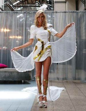 Golden girl ... Renae Ayris in the national costume on Wednesday.