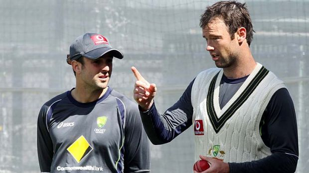 Opener Ed Cowan (left) talks to Rob Quiney in training.
