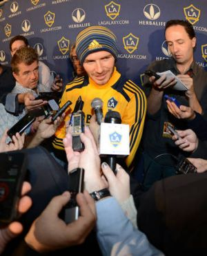 David Beckham speaks to reporters after announcing his impending departure from LA Galaxy.