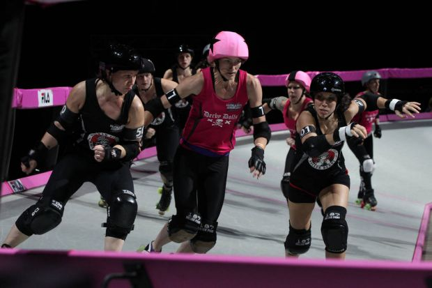 Two Gotham City girls prepare to put the squeeze on a Derby Doll.