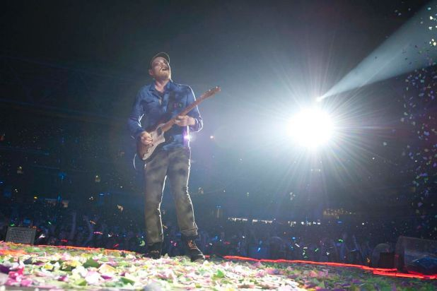 Jonny Buckland plays guitar as Coldplay perform at Suncorp Stadium.