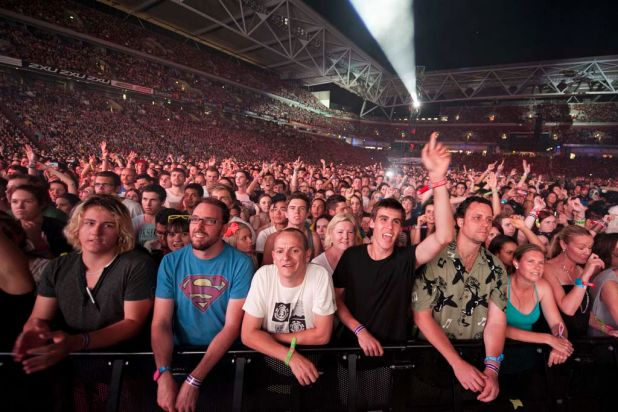 Fans watch Coldplay perform their final Australian show for 2012 at Suncorp Stadium in Brisbane.