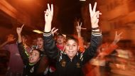 Palestinian boys celebrate what they say is a victory over Israel after an eight-day conflict in Gaza City November 21, ...