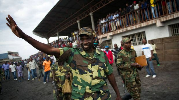 'We will go to Kinshasa' ... Lieutenant-Colonel Vianney Kazarama waves at a crowd as he arrives at the Volcanoes Stadium ...