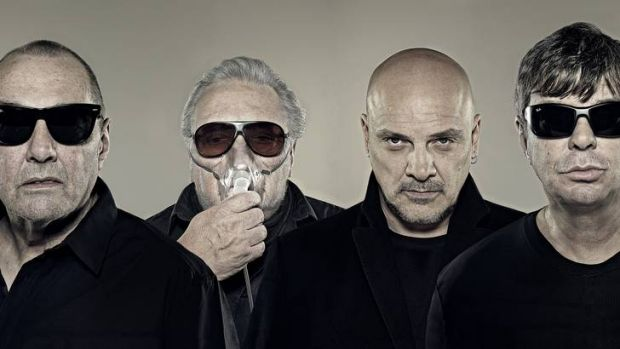 The Stranglers (from left to right), keyboardist Dave Greenfield, drummer Jet Black, vocalist Baz Warne and bassist ...