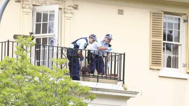 Police on the balcony of Jim Byrnes's Bellevue Hill home.